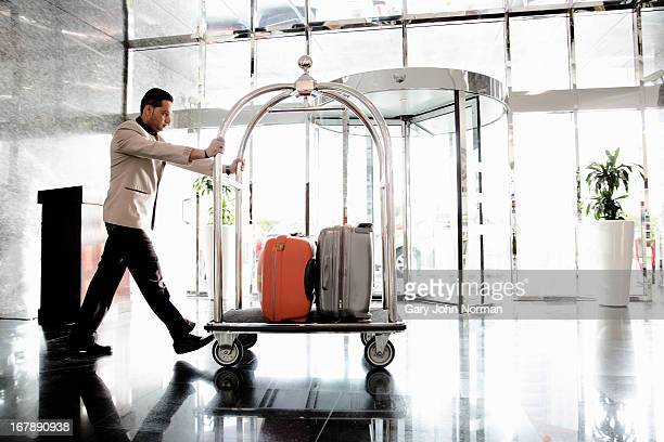 Bellboy pushing luggage trolley