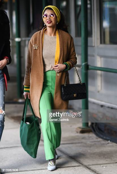 Belle Bakst is seen wearing an HM coat and vintage pants outside the Tadashi Shoji show during New York Fashion Week Women's A/W 2018 on February 8...
