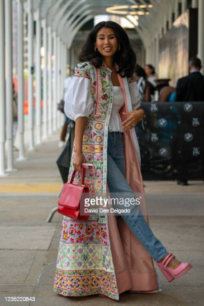 Belle Bakst is seen wearing vest by Alice & Olivia, shirt by Cynthia Rowley, jeans by Mavi, shoes by SteveMadden and a vintage hand bag at Spring...