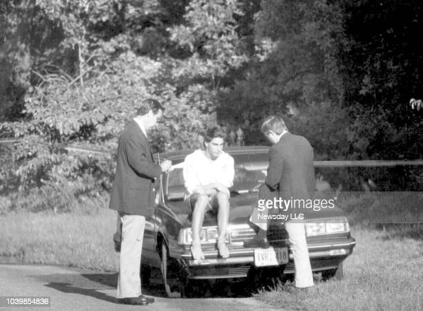 Suffolk homicide detectives Norman Rein and Robert Doyle interview Martin Tankleff outside the Tankleff's Belle Terre New York home on September 7...