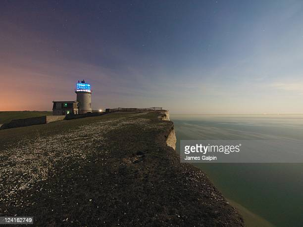 belle tout lighthouse in moonlight - belle tout lighthouse stock photos and pictures