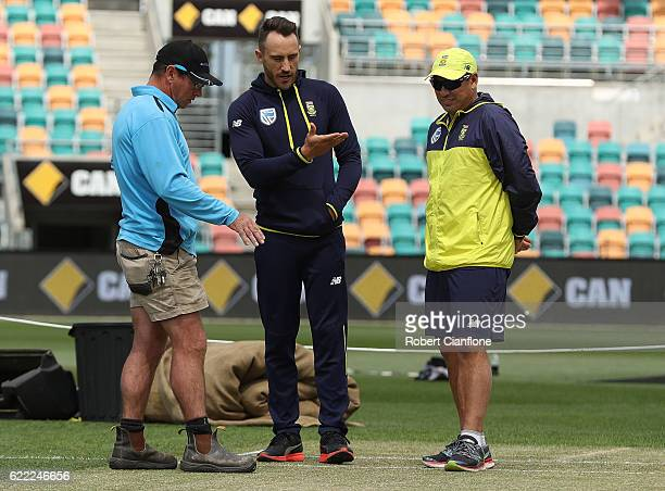 Bellerive Oval curator Marcus Pamplin speaks with Faf du Plessis of South Africa and Russell Domingo coach of South Africa as they check the pitch...