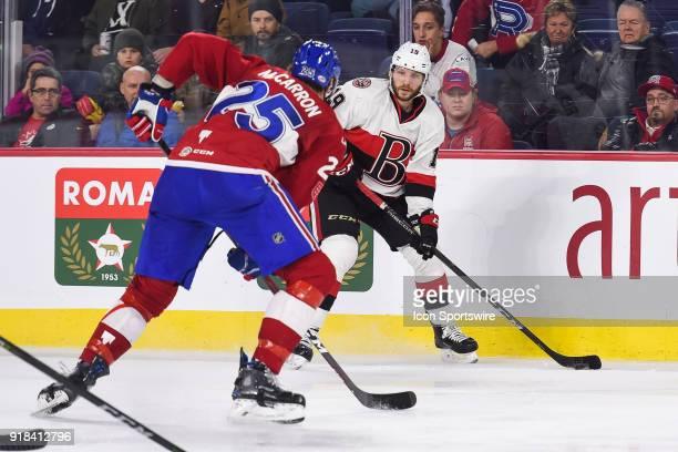 Belleville Senators center Max Reinhart looks for a pass target in front of Laval Rocket right wing Michael Mccarron during the Belleville Senators...