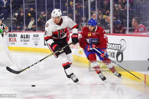 Belleville Senators right wing Gabriel Gagne tries to skate away with the puck while chased by Laval Rocket left wing Jordan Boucher during the...