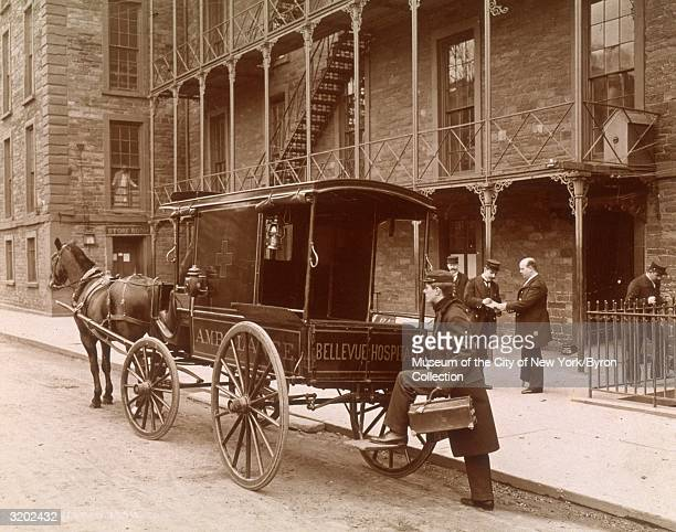 Bellevue Hospital ambulance driver boards a horsedrawn ambulance as it prepares to leave the hospital yard New York City