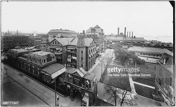 Bellevue Hospital New York New York mid 1900s View looking north from 26th Street between First Avenue and the East River Queensboro Bridge visible...