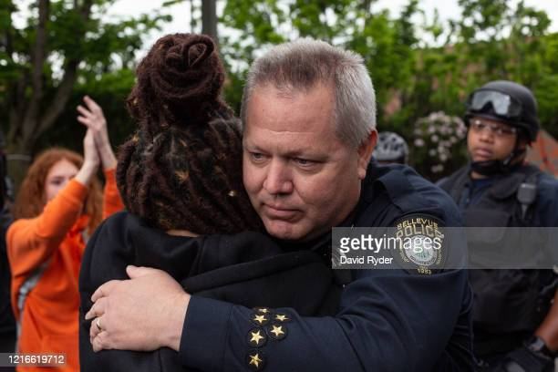 Bellevue Police Chief Steve Mylett hugs a demonstrator during a gathering to protest the recent death of George Floyd on May 31 2020 in Bellevue...