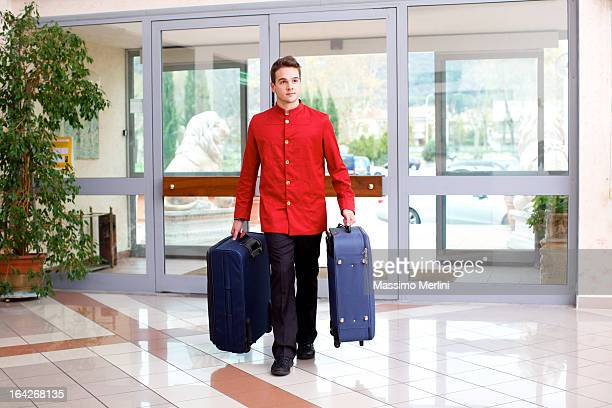 Bellhop carrying luggage