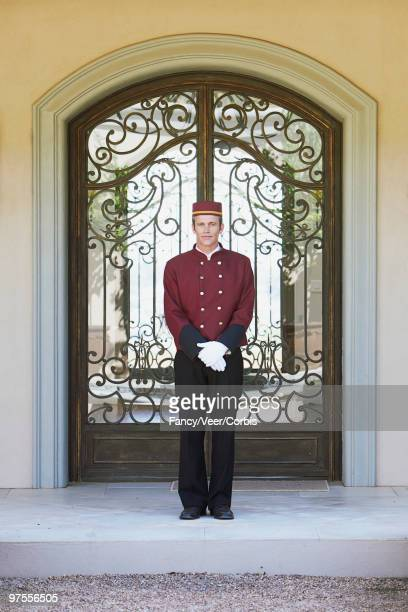 Bellhop in front of hotel