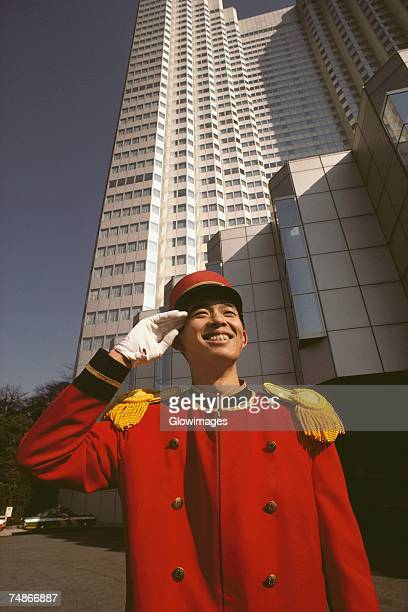 Bellhop saluting in front of a hotel, Tokyo Prefecture, Japan