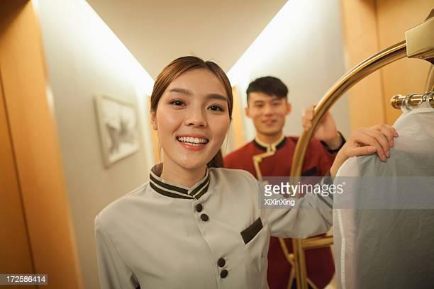 Bellhops in the doorway smiling, portrait
