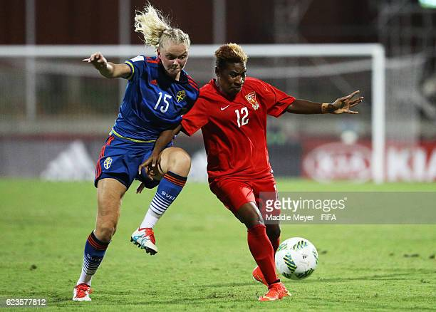 Bellinda Giada of Papua New Guinea shields the ball from Amanda Persson of Sweden during the first half of their Group A match of the FIFA U20...