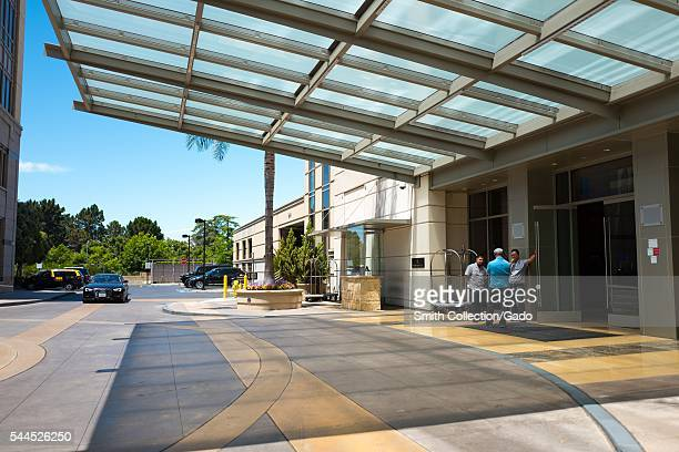 Bellmen await the arrival of guests outside the entrance of the Four Seasons Hotel Silicon Valley, East Palo Alto, California, 2016. The hotel is a...