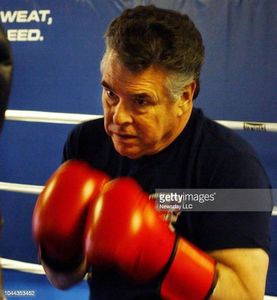 Congressman Peter King getting a workout boxing with his trainer in Bellmore New York on December 20 2004