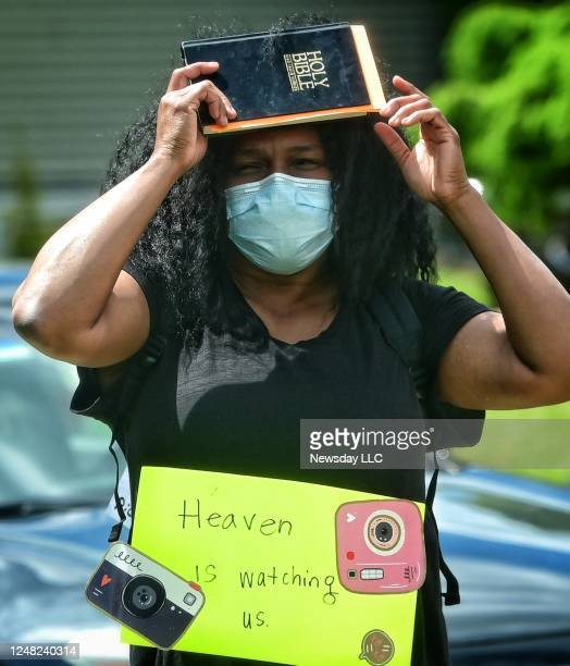 Woman holds a bible while members of clergy and laity from area churches and synagogues march in New York against racism and to honor George Floyd on...