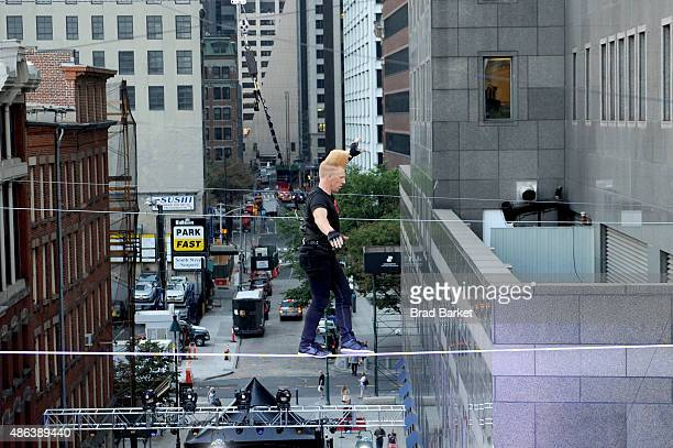 Bello Nock walks the highwire at the Impractical Jokers 100th Episode Live Punishment Special at the South Street Seaport on September 3 2015 in New...