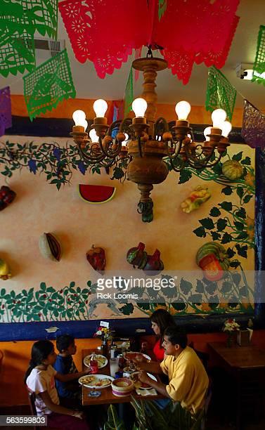 Bell––Priscilla Roman David Roman and their parents Yolanda and Hector Roman of Los Angeles eat at Cenaduria La Casita Mexicana an authentic Mexican...