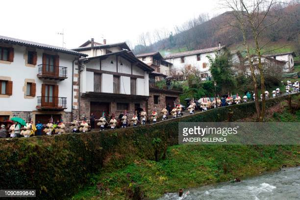 Bellringers known as 'Joaldunak' in Basque march with big cowbells hanging on their back during celebrations of the ancient carnival of Zubieta in...