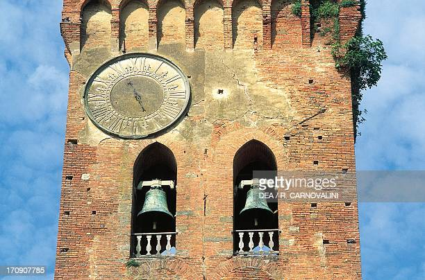 Bells and clock of Matilda's Tower, Romanesque-style bell tower next to the Cathedral of Santa Maria Assunta and St Jenesien, San Miniato, Tuscany,...