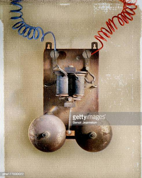 Bells tied to electric cables