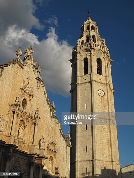 Belltower and monumental facade of St John the Baptist parish temple of Alcala de Xivert is a magnificent building of classical Valencian baroque...