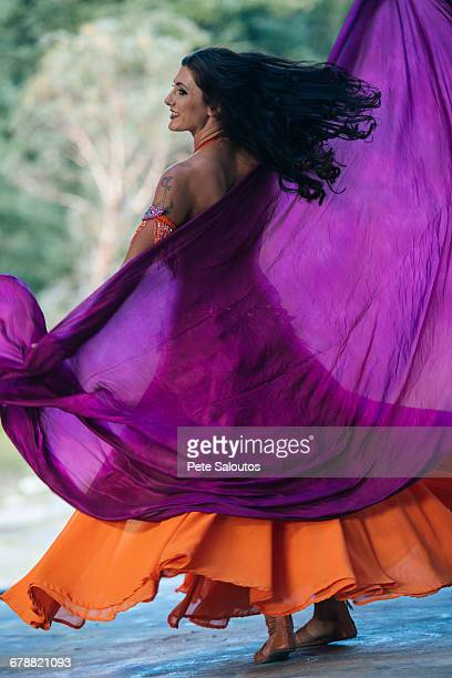 belly dancer holding purple fabric - purple dress stock pictures, royalty-free photos & images