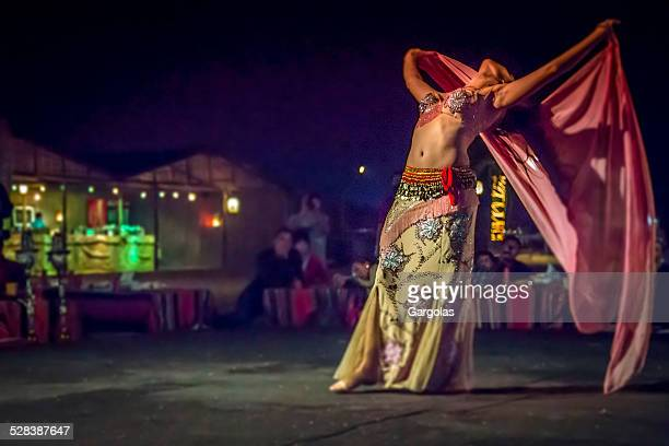 belly dancer in action with multicolored costume - belly dancer stock photos and pictures