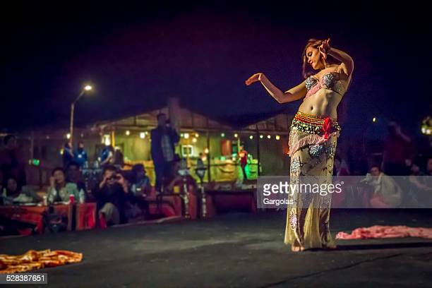 belly dancer in action with multicolored costume - belly dancing stock photos and pictures