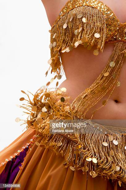 belly dancer in golden dress - belly dancing stock photos and pictures