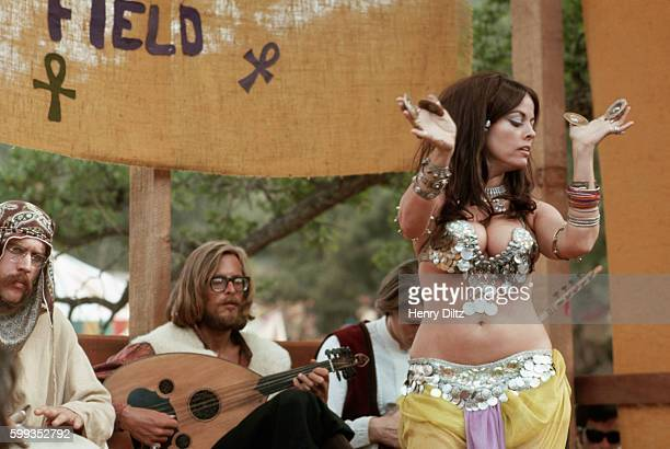 A belly dancer performs at a renaissance fair