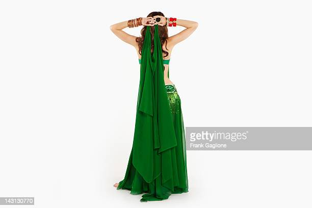 belly dancer posing. - belly dancing stock photos and pictures