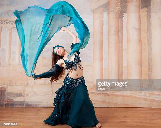 belly dancer throwing veil in the air - belly dancing stock photos and pictures