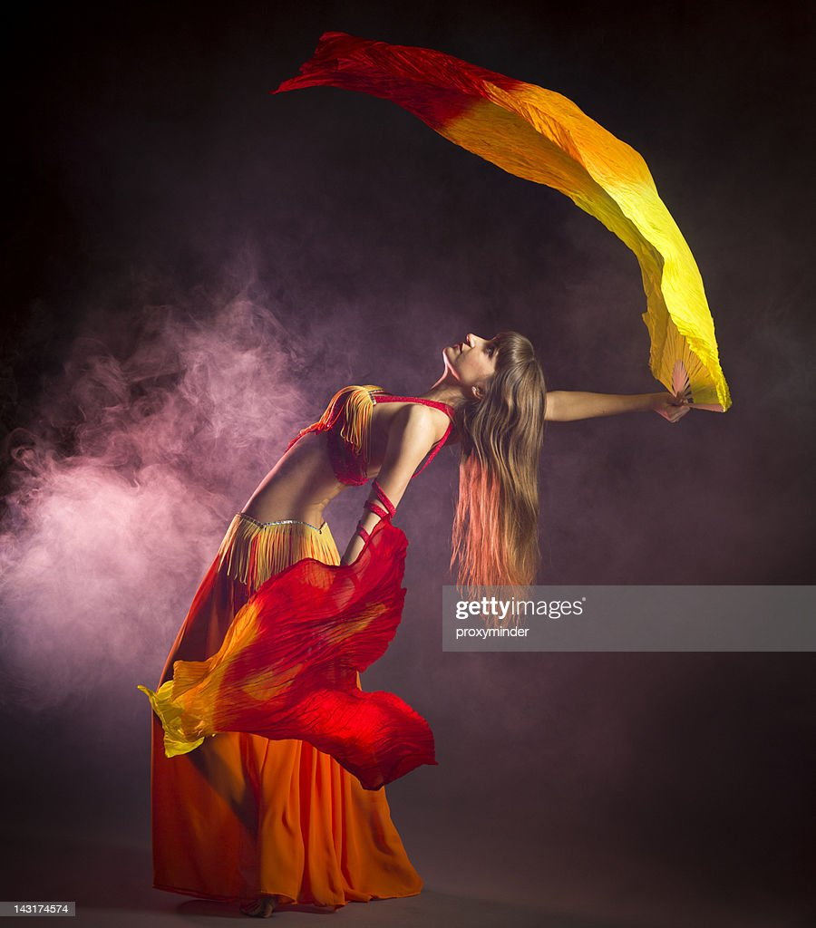 Belly dancer with colorful Fan Veils : Stock Photo