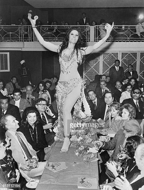 Belly dancer Zizi Mostafa provides after dinner entertainment for Mrs Jacqueline Kennedy Onassis and her husband Greek shipping millionaire Aristotle...