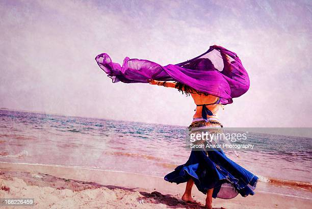 belly dancing at the beach - belly dancing stock photos and pictures