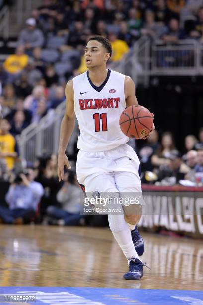 Belmont Bruins Guard Kevin McClain dribbles the ball during the Ohio Valley Conference Championship college basketball game between the Murray State...