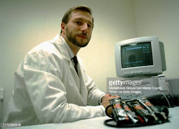 Belmont, CA December 10, 1998: Dr. Andrew Maxwell of Cooke Pharma with a cardio vascular ultrasound machine and heart bars. Cooke Pharma develops...