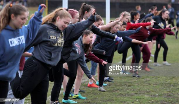 Belmont players stretch during pre-practice exercises at a rugby practice session at Belmont High School in Belmont, MA on April 2, 2018. When Greg...