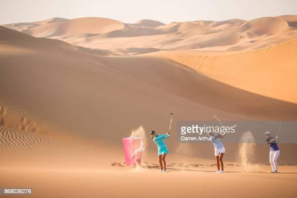 Belén Mozo of Spain Amy Boulden of Wales Inci Mehmet of England pose on sand dunes ahead of the Fatima Bint Mubarak Ladies Open on October 28 2017 in...