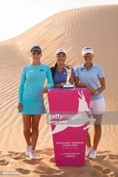 Belén Mozo of Spain Inci Mehmet of England and Amy Boulden of Wales pose on sand dunes ahead of the Fatima Bint Mubarak Ladies Open on October 28...