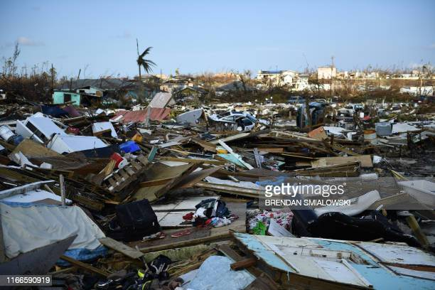 Belongings litter the ground in the Mudd neighborhood of Marsh Harbour Great Abaco on September 7 in the aftermath of Hurricane Dorian Bahamians who...