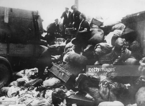 Belongings of deported Jews is searched for valuables Photograph 1944