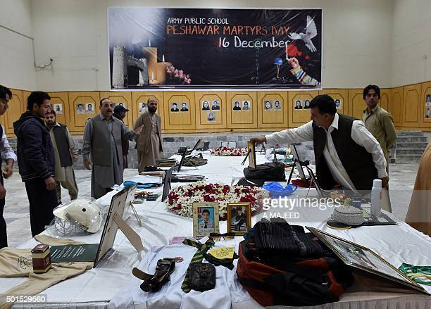Belongings of people who died in the Taliban school massacre that left 151 people dead are displayed in a library on the first anniversary of the...