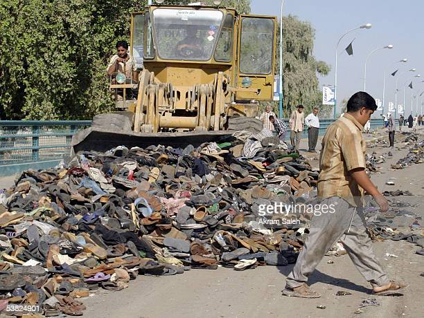 Belongings of Shiite pilgrims lost in a stampede are removed from a bridge on September 2005 in Baghdad Iraq Funerals were held today for the victims...