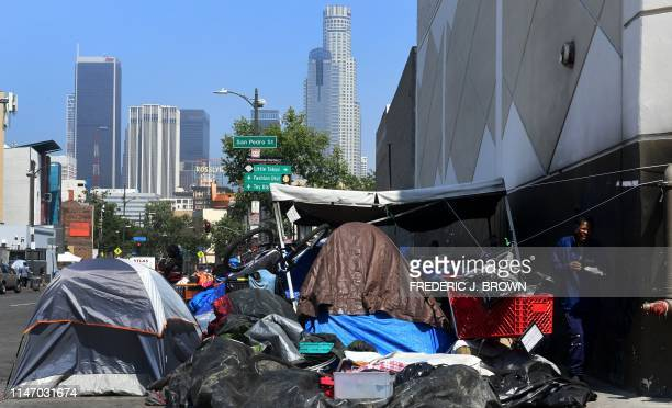 Belongings of the homeless crowd a downtown Los Angeles sidewalk in Skid Row on May 30 2019 The city of Los Angeles on May 29 agreed to allow...