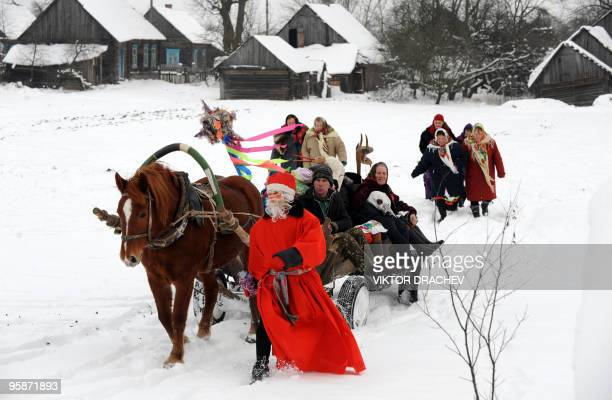 Belorussians celebrate the Christmas carol rite in the village of Pogost some 250 km southeast of Minsk on January 7 2010 Koliady is an ancient pagan...