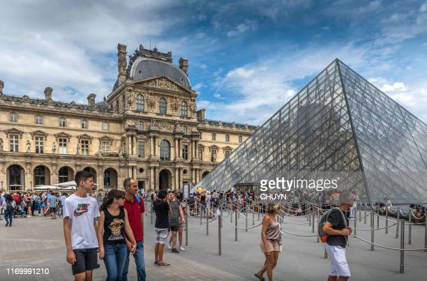 beloved louvre - louvre pyramid stock pictures, royalty-free photos & images