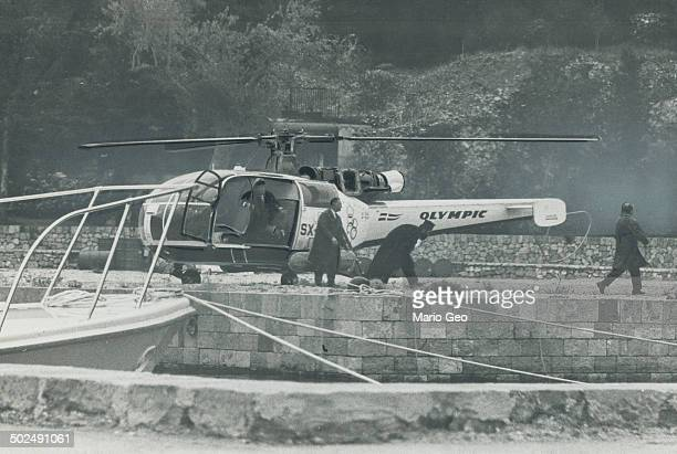 Below is the Greek Orthodox priest who married them emerging from helicopter
