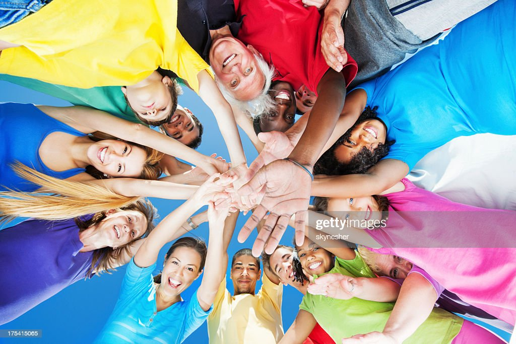 Below view, circle of arms with hands in center : Stock Photo