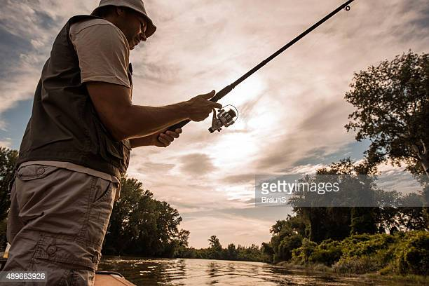 Below view of a fisherman fly-fishing on the river.